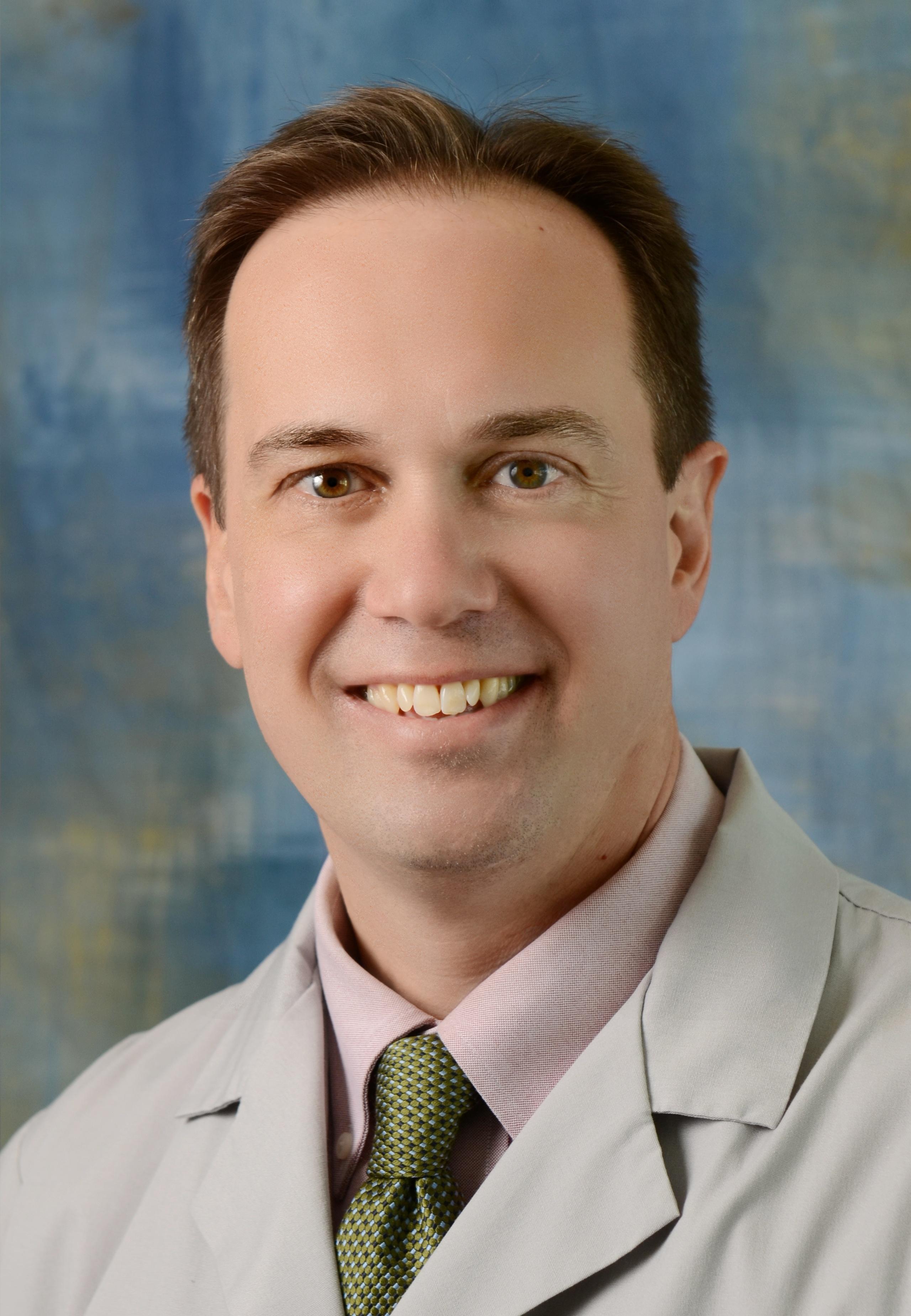 William E. Trick, MD