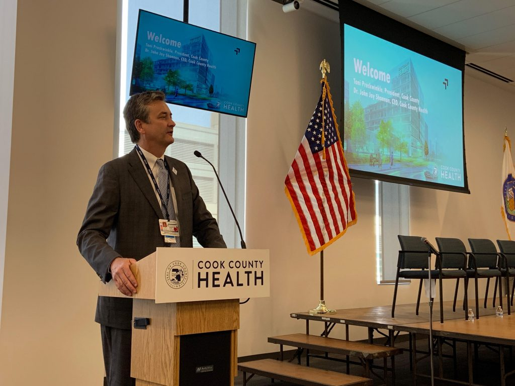 """Cook County Health CEO Dr. Jay Shannon at the Cook County Health Research and Innovation Summit, """"Housing is Health."""""""